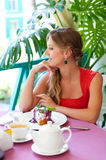 Woman having breakfast at a cafe Stock Photo
