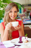 Woman having breakfast at cafe Royalty Free Stock Photography