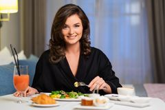 Woman having breakfast in a hotel Royalty Free Stock Photo