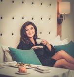 Woman having breakfast in a hotel Stock Photo