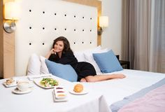 Woman having breakfast in a hotel Royalty Free Stock Images