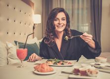 Woman having breakfast in a hotel Stock Photos