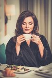 Woman having breakfast in a hotel Stock Image