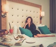 Woman having breakfast in a hotel Royalty Free Stock Photos