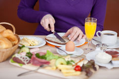 Woman having breakfast in hotel Royalty Free Stock Image