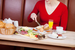 Woman having breakfast in hotel Stock Image