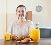 Woman having breakfast with juice Stock Photography
