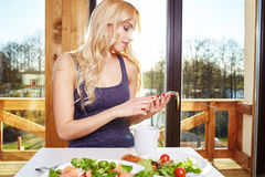 Woman having breakfast in kitchen Royalty Free Stock Images