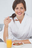 Woman having breakfast with orange juice and cereals Stock Images