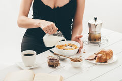 Woman having breakfast. Stock Images
