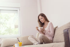 Woman having breakfast Royalty Free Stock Images