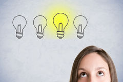Woman Having a Bright Idea Stock Photography