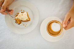 Woman having cake and coffee Stock Photo