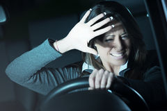 Woman having a car accident Stock Photography