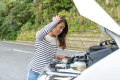 Woman having car problem at road. Asian young beautiful woman portrait Stock Photos
