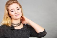 Woman having chain around neck Stock Photo