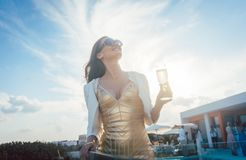 Woman having champagne at summer party royalty free stock photo