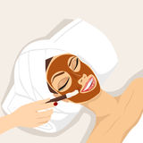 Woman having chocolate mask treatment therapy Royalty Free Stock Images
