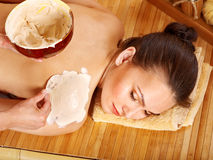 Woman  having clay body mask. Stock Images