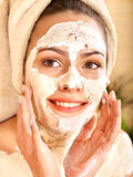 Woman  having clay body mask. Royalty Free Stock Image