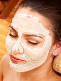 Woman  having clay facial mask. Royalty Free Stock Photo