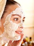 Woman  having clay facial mask. Stock Images