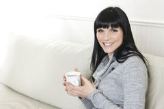 Woman having a coffee Stock Photos