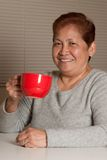 Woman having coffee Stock Images