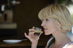 Woman having a coffee break Stock Photography