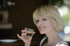 Woman having a coffee break Royalty Free Stock Image
