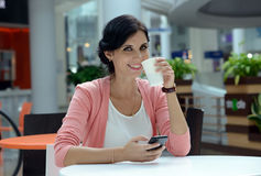Woman having a coffee-break Royalty Free Stock Photography