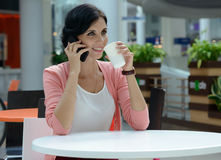 Woman having a coffee-break Royalty Free Stock Images