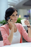 Woman having a coffee-break Stock Photography