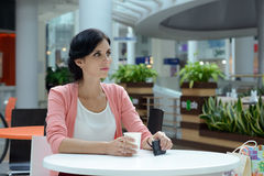 Woman having a coffee-break Stock Images