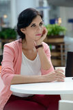 Woman having a coffee-break Stock Image
