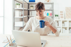 Woman having a coffee break and networking Royalty Free Stock Photography