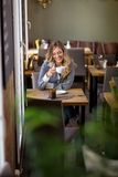 Woman Having Coffee At Cafe Royalty Free Stock Photography