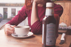 Woman having coffee in cafe Royalty Free Stock Images