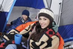 Woman Having Coffee While Camping With Son Royalty Free Stock Photos