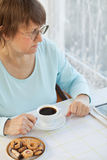 Woman having coffee with cookies Royalty Free Stock Photo