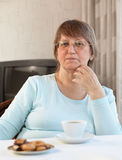 Woman having coffee with cookies Stock Photos