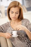 Woman having coffee on couch Royalty Free Stock Photography