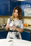 Woman having coffee at home Royalty Free Stock Images