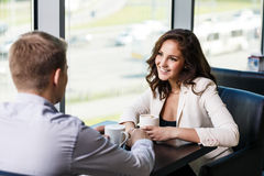Woman having coffee with a man in cafe Royalty Free Stock Image