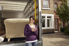 Woman Having Coffee By Moving Truck Stock Photography