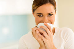Woman having coffee Royalty Free Stock Image
