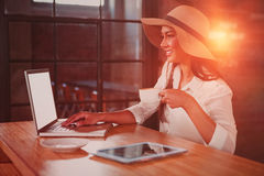 Woman having coffee while using laptop in cafe royalty free stock photos