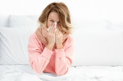 Woman having a cold, flu. Sore throat and coughing. Woman having a cold, flu. Sore throat, coughing and fever Stock Images