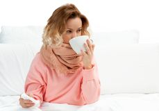 Woman having a cold, flu. Sore throat and coughing. Woman having a cold, flu. Sore throat, coughing and fever Royalty Free Stock Images