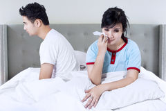 Woman having conflict with husband on bed Stock Images